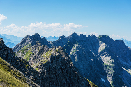 recedes: Nature background with tall Alps Mountains and beautiful green side during summer in Allgau Germany Stock Photo