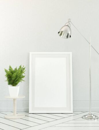 floor plant: Fern plant beside floor lamp over blank white picture frame leaning against neutral color wall