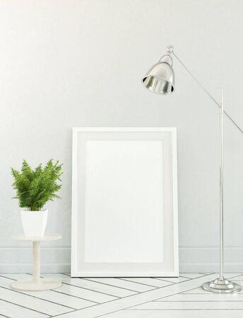 design frame: Fern plant beside floor lamp over blank white picture frame leaning against neutral color wall