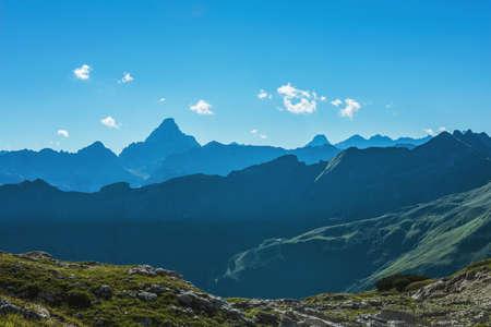 recedes: Grosser Daumen Alps mountain range with deep dark valley in foreground with copy space