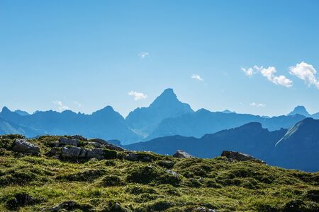recedes: Mountains near the Grosser Daumen range with green rocky foothills in the foreground Stock Photo