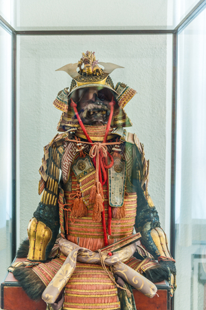 asian warrior: Augsburg, Germany - September 08, 2016: Helmet and chest portions of ancient Asian warrior armor on display in museum case indoors in Germany Editorial