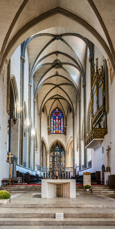 Augsburg, Germany - September 08, 2016: Gothic interior of the Catholic Augsburg Cathedral with its vaulted ceiling and long narrow nave in a travel, architecture and tourism concept Editorial