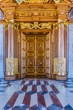 architrave: Augsburg, Germany - September 08, 2016: Floor and door detail of the Golden Hall in the town hall Augsburg showing the inlaid stone leading to ornate doors with columns and architrave