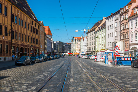 recedes: Augsburg, Germany - September 08, 2016: View down Maximilian Street, Augsburg along the tram tracks with historic buildings lining either side on a sunny blue sky day