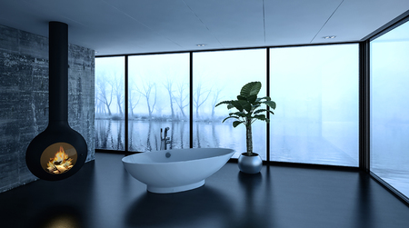 waterfront: Cozy modern bathroom in winter with a freestanding bathtub alongside a glowing wood fire in a burner and wrap around windows overlooking a misty waterfront with bare trees and reflections, 3d render Stock Photo