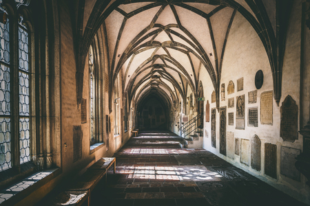 Augsburg, Germany - September 08, 2016: View down end of empty hallway in old historical gothic German church of the Augsburg