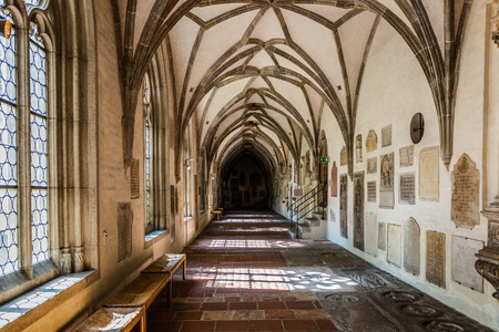 Augsburg, Germany - September 08, 2016: Dark end of empty hallway in old historical gothic German church of the Augsburg