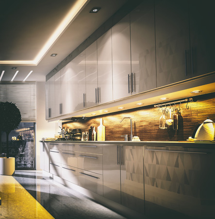 down lights: Stylish modern fitted kitchen interior with built in appliances and cabinets lit by illuminated down lights in a square format, 3d rendering
