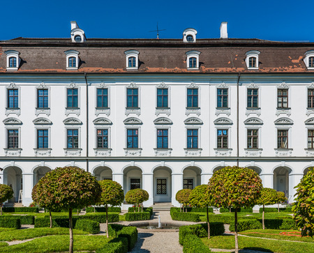 Augsburg, Germany - September 08, 2016: Baroque facade of the Schaezlerpalais , Augsburg, Bavaria, Germany with its formal gardens and topiary on a sunny blue sky day. Editorial