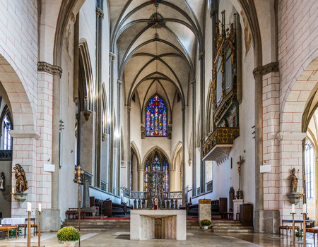 ecclesiastical: Augsburg, Germany - September 08, 2016: Interior of the Augsburg Cathedral, Bavaria, Germany looking down the nave with its vaulted Gothic ceiling in a travel concept Editorial