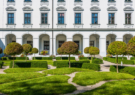 topiary: Augsburg, Germany - September 08, 2016: Formal gardens and classic white Baroque facade of the Schaezlerpalais, Augsburg, Bavaria, Germany now an art museum and monument