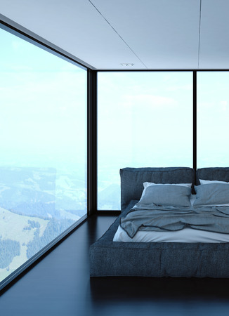 ambient light: 3d rendered bedroom with unmade bed and hills in background. Tall glass windows and ambient light. Stock Photo