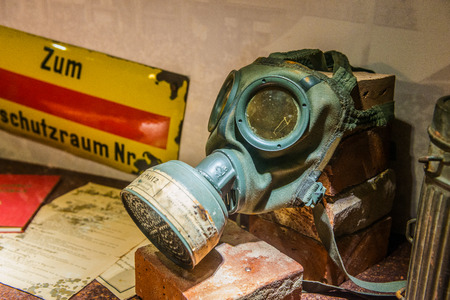 memorabilia: Augsburg, Germany - September 08, 2016: Old WW1 gas mask on display in the Fuggerei museum in Augsburg, Bavaria, Germany with an assorted collection of memorabilia. Editorial