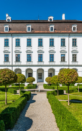 hedge: Augsburg, Germany - September 08, 2016: Exterior view of the classical white facade of the Schaezler Palace museum, or Schaezlerpalais, Augsburg, Bavaria, Germany in a travel concept