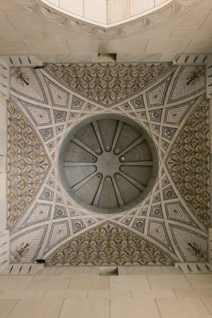 entryway: Low angle view of decorative ceiling of entryway on stone religious building Editorial