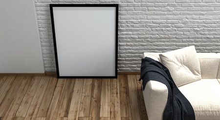 cream colored: Large blank picture frame standing on a wooden floor leaning on a textured rough white wall alongside a cream colored couch with a black throw rug, high angle partial view 3d render Stock Photo