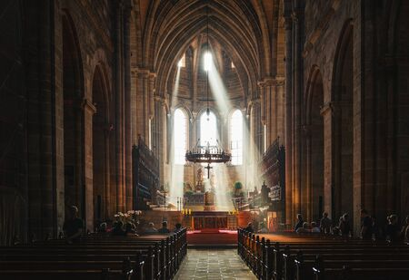 Light streaming through the windows of Bamberg Cathedral, Germany lighting up the altar in a spiritual scene