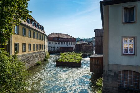 recedes: River Regnitz in historic medieval city of Bamberg, Germany
