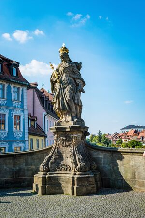 bayern old town: Low angle view of bronze statue of Kunigunde with gold crown and scepter on a pedestal
