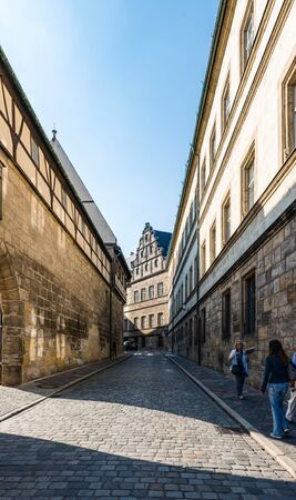 recedes: Narrow road near cathedral square in Bamberg, Germany with historic buildings