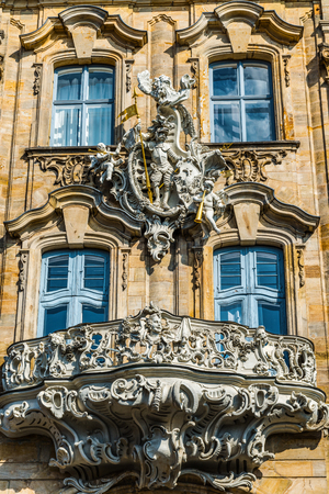 old building facade: Ornate historic Baroque carved stone balcony on the exterior facade of an old building in Bamberg, Germany Editorial