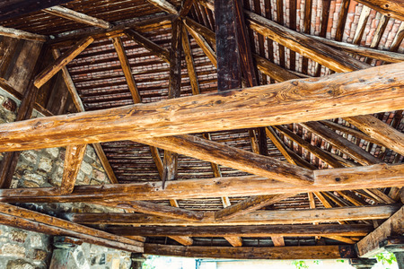 rafters: Interior framework of stone and wooden building as seen from a low angle view Stock Photo