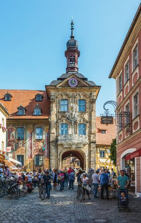 thronged: View down a cobbled street thronged with people of the old historic Town Hall, Bamberg, Southern Franconia, Germany built on an island in the Regnitz River