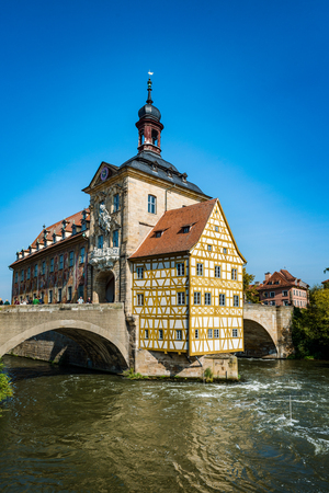 rathaus: Old historic baroque Town Hall, Bamberg, Germany with its timbered frescoed walls built on an island in the Regnitz River accessed by two arched stone bridges