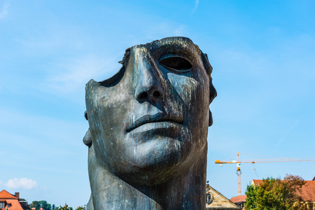 igor: Creative half finished aged bronze sculpture as seen from a low angle view