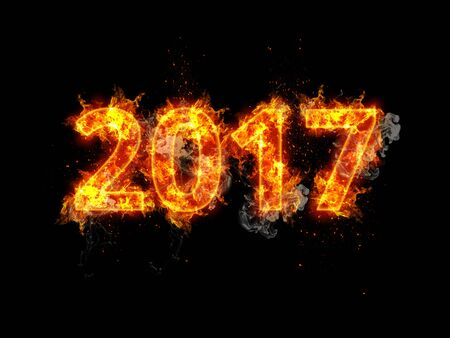 incendiary: Fiery 2017 New Years date with burning numerals consumed by tongues of orange flame over a dark background with copy space Stock Photo