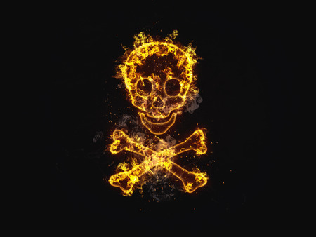 Flaming skull and crossbones pirates symbol engulfed in burning orange flames and sparks over a black background with copy space