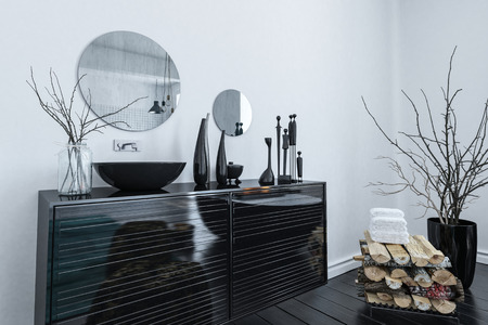 Modern black and grey bathroom interior with an elegant lacquered vanity cabinet and assorted ornaments, 3d render Stock Photo