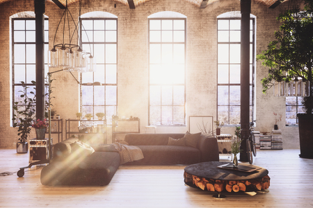 indentation: Hipster modern loft conversion with stylish open plan interior with sofas, chandeliers and potted tree in front of tall windows with sun flare. 3d Rendering.