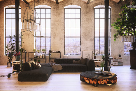 Converted loft interior with high graceful arched windows in a brick wall and modern lounge furniture with a potted tree and houseplants, 3d rendering