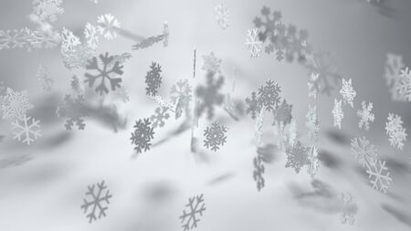 wide angle: Seasonal winter or Christmas background with an assorted variety of falling snowflakes on a misty atmospheric grey backdrop in wide angle format with copy space for your holiday greeting Stock Photo