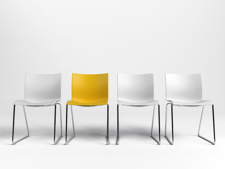Line of three white and one yellow chairs against a white background with copy space in a conceptual image. 3d rendering.