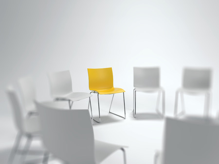 Individual yellow chair in a circle of blurred white ones with selective focus in a concept of leadership, diversity and individualism, copy space above. 3d rendering.