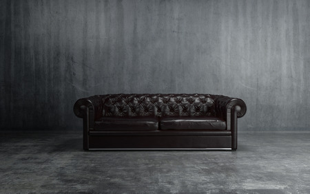 black floor: Sofa of black leather standing in center on concrete floor against dark grey wall with copy space. 3d Rendering.