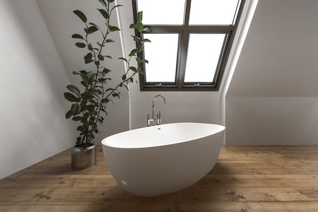 Contemporary attic bathroom with simple tub under slanted window near house plant