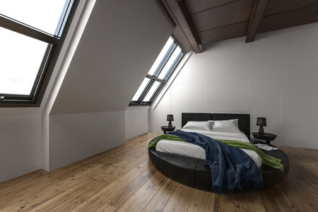 modern apartment: Modern attic apartment with slanted windows and unusual round bed on hardwood floors