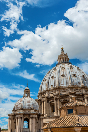 basilica: Domed cupola of St Peters Basilica in the Vatican, Rome, Italy against a cloudy blue sky Stock Photo