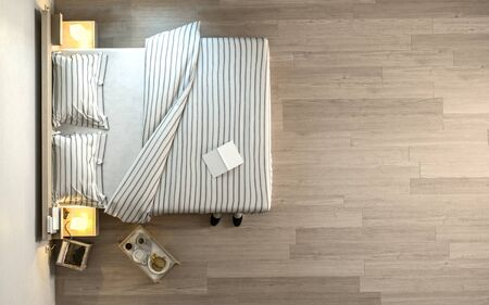 book: From above view of wide bed with striped linens, book and little portable coffee table on wooden parquet floor. Copy space. 3d Rendering.