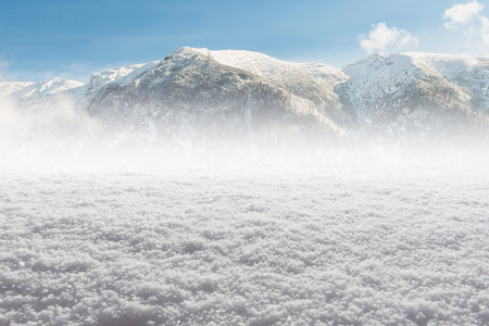 powdery: Winter snow ice Background with snowflakes and blurred mountains far behind