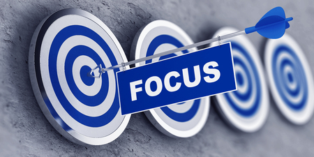 FOCUS concept with a banner on an arrow penetrating the center bulls eye on a target. 3d Rendering.