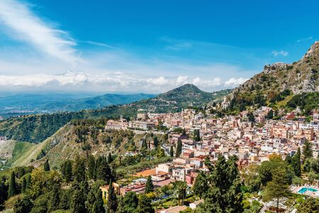 Aerial cityscape view of Taormina, located on a hillside in Sicily, Italy Stock Photo