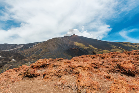Panoramic view of Mount Etna volcano in Sicily with cloudscape background Stock Photo
