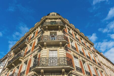 decorative balconies: Corner angle of a historic townhouse with ornate wrought iron balconies and brick and stone architecture in Strasbourg, Alsace, France Editorial
