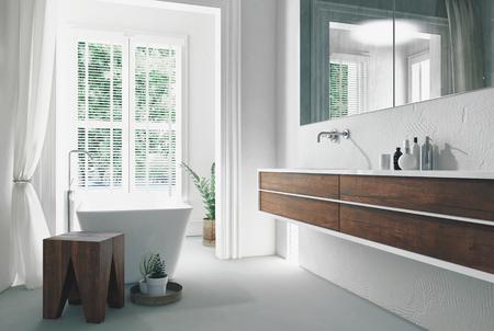 壁とモダンな明るい日当たりの良い白いバスルームのインテリアには、洗面化粧台とミラーと大きな窓の前に独立したバスタブをマウントされてい