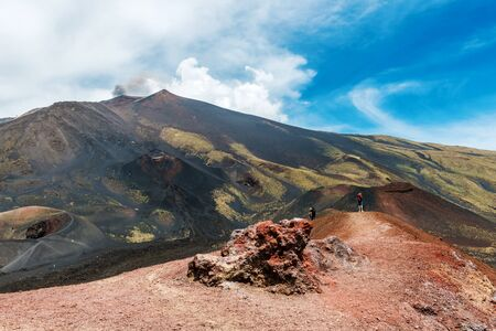Panoramic view of Mount Etna volcano with solidified lava flow in foreground, Sicily